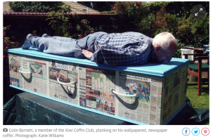 Man-Atop-His-Own-Coffin-he-Built